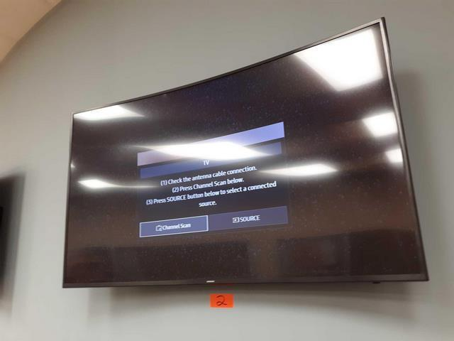 Samsung 65-inch curved television with remote - need to be removed