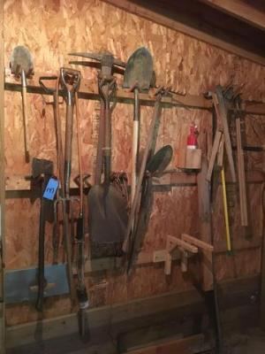 Lot of various yard tools include shovels, rakes, axe etc..