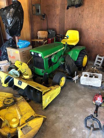 John Deere 140 riding mower with crib and back tiller