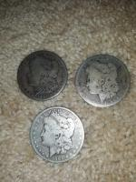 3 - Morgan silver dollars - 1881 1884 and 1891