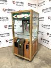 Coin operated claw machine - on wheels