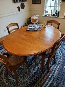 "vintage chestnut table with 8 leaves - table 36"" dia. leaves 12"" - 4 cane seat chairs - pic shows table and 2 leaves"