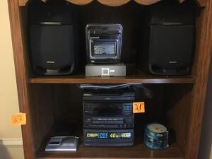 Aiwa stereo system and some cds