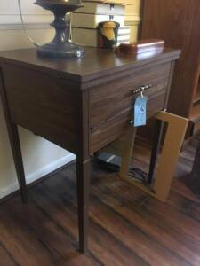 Wooden end table height:31in width:27in contents not included