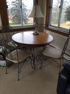 "Kitchen table and chairs- oak top with wrought iron legs - 42"" round x 29"" high- 4 chairs"