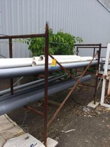 Steel rack with pvc pipe - approximately 63 d x 65 h x 12 feet long