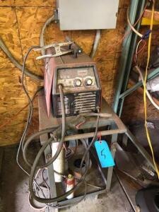 Century 125GS wire feed welder on cart
