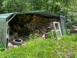 13ft x 15ft x 7.5 ft metal wood shed (contents not included)