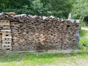 large lot of cut stacked fire wood (flag and pots not included)
