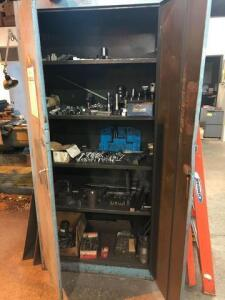 Cabinet full of machine bits and metal blocks