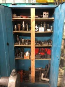 Metal cabinet filled with drill bits and parts
