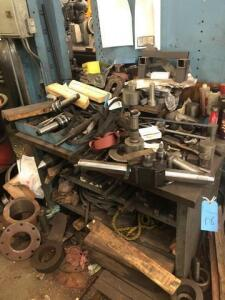 Metal table and cabinet full of lathe parts/tools