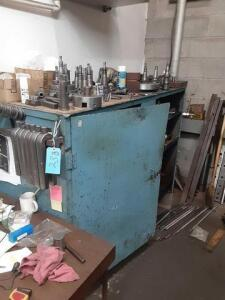 Large metal bin with shelves inside... 2ft x 4ft x 6ft.... with all contents ... large lot of bits and chucks for lathe ... metal table is 25x50x72 inches