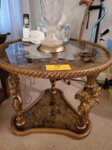 "Lovely glass topped table - gold tone - 28"" across x 22"" h - contents not included - detailed legs - patterned glass"
