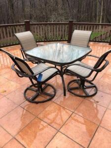 "Outdoor glass top table with 4 chairs (table is 44""x27""x44"") 1 chair has rip"