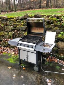 Kenmore elite gas powered grill with side propane burner and cover (cover is torn)