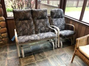 2 outdoor metal rocking chairs
