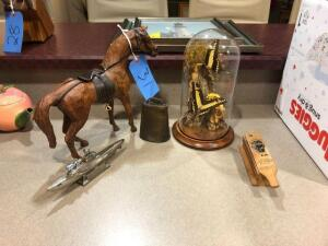 Wooden horse statue, cow bell, U-581 lighter, butterfly display with box call