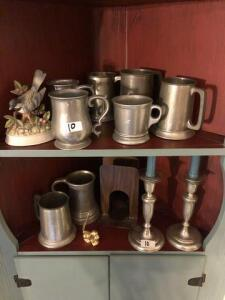 lot of pewter mugs and silver plated candlesticks