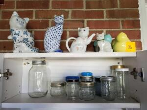Contents of cabinet - jars - cat collection - Fenton cat signed by s. Hopkins - teapot cat - Andrea hand painted cat - ceramic cat