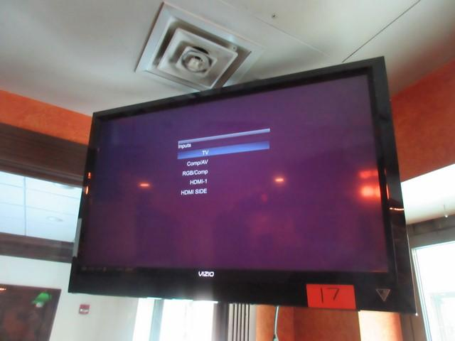 Vizio 38 inch full HD 1080p television mounted to ceiling