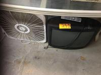 Lot of TVs and box fan
